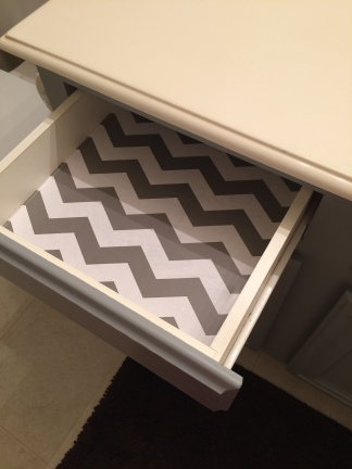 Even the vanity drawer liners match!